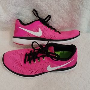 Women's 8.5 fluorescent pink Nike tennis shoes